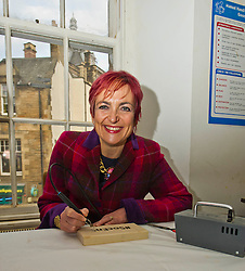 Pictured: Angela Constance has a go at burning an appropriate hashrag diring her visit<br /> <br /> Communities Secretary Angela Constance MSP visited the Grassmarket Community Project today to see how a successful social enterprise works. While she was there, Ms Constance launched the Scottish Government's social enterprise strategy.<br /> <br /> Ger Harley | EEm 14 December 2016