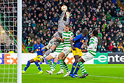 Craig Gordon (#1) of Celtic FC misses a cross in a crowded penalty box during the Europa League group stage match between Celtic and RP Leipzig at Celtic Park, Glasgow, Scotland on 8 November 2018.