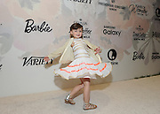 """Sydney """"Mayhem"""" Keiser, founder of Fashion by Mayhem, debuts a dress from her """"Little Mayhem for J. Crew"""" collection at the Variety Power of Women event, Friday, April 24, 2015, in New York, where she was honored by Barbie.  (Photo by Diane Bondareff/Invision for Barbie/AP Images)"""