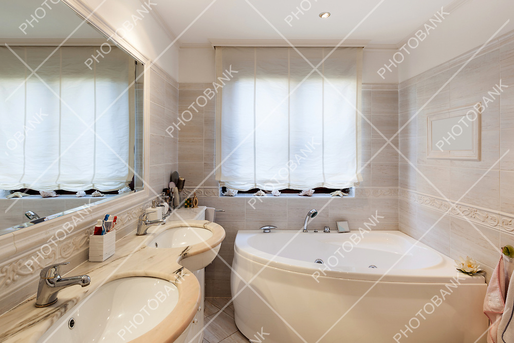 Bathroom of a modern apartment, marble cladding
