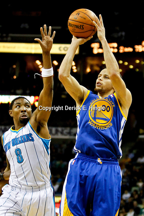Jan 19, 2013; New Orleans, LA, USA; Golden State Warriors point guard Stephen Curry (30) shoots over New Orleans Hornets shooting guard Roger Mason Jr. (8) during  the second half of a game at the New Orleans Arena. The Warriors defeated the Hornets 116-112. Mandatory Credit: Derick E. Hingle-USA TODAY Sports