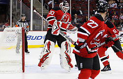 Oct 17, 2009; Newark, NJ, USA; New Jersey Devils goalie Martin Brodeur (30) makes a leaping save during the first period of their game against the Carolina Hurricanes at the Prudential Center.