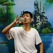 A man drinks from a bottle of ruou - Vietnamese rice wine - in Ha Giang, Vietnam's northernmost province.