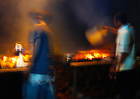 Surreal photo of fish grill boys in north Bali, Indonesia.