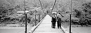 Young boys on long wooden bridge