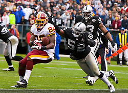 December 13, 2009; Oakland, CA, USA;  Washington Redskins tight end Fred Davis (86) makes a touchdown catch in front of Oakland Raiders linebacker Kirk Morrison (52) during the second quarter at Oakland-Alameda County Coliseum.  Washington defeated Oakland 34-13.