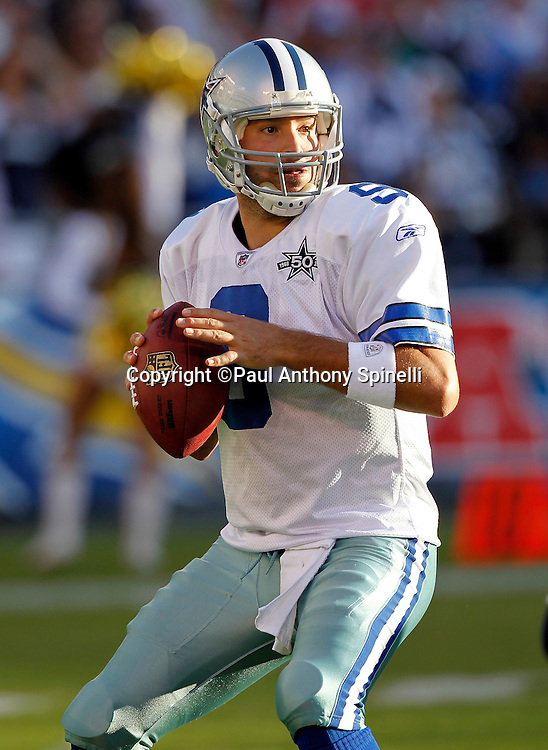 Dallas Cowboys quarterback Tony Romo (9) drops back to pass during pregame warmups at the NFL week 2 preseason football game against the San Diego Chargers on Saturday, August 21, 2010 in San Diego, California. The Cowboys won the game 16-14. (©Paul Anthony Spinelli)