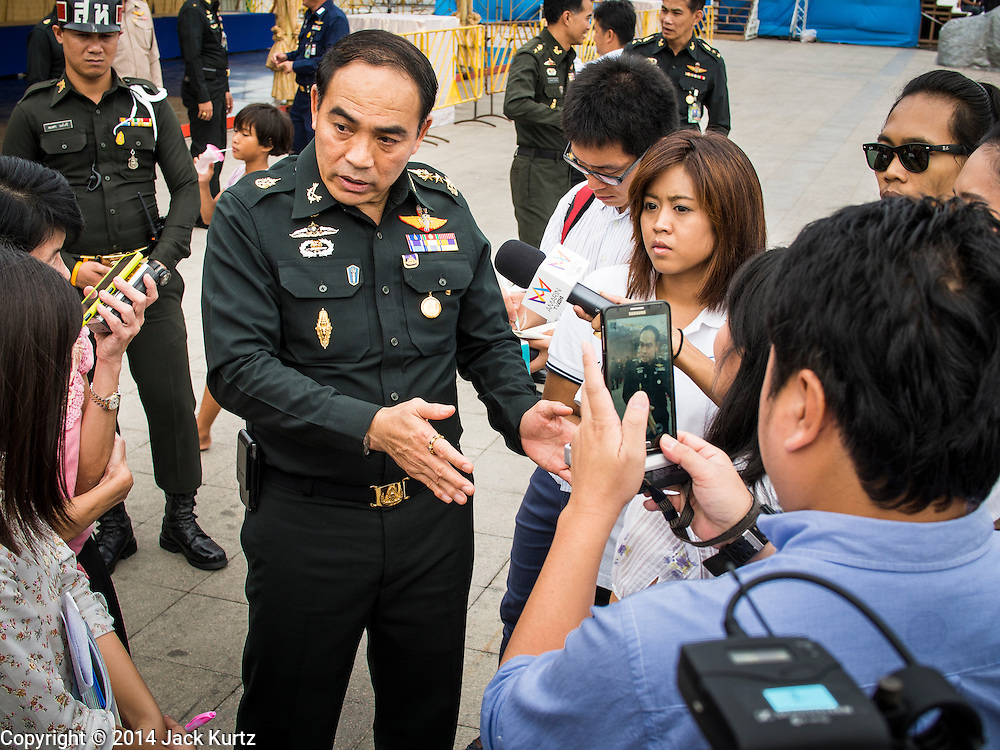"22 JULY 2014 - BANGKOK, THAILAND: Thai Army Lt. General SURASAK KANCHANARAT talks to reporters after a merit making ceremony at Sanam Luang.  Hundreds of Thai military officers and civil servants attended a Buddhist chanting service and merit making ceremony to mark the 2nd month anniversary of the May 22 coup that deposed the elected civilian government and ended nearly six months of sometimes violent anti-government protests. The ruling junta said the ceremonies Tuesday were the kickoff to a ""Festival to Bring Back Happiness of the People of the Nation."" There will be free concerts, historical pageants and movies at Sanam Luang, a large parade ground near the Ministry of Defense in Bangkok.    PHOTO BY JACK KURTZ"