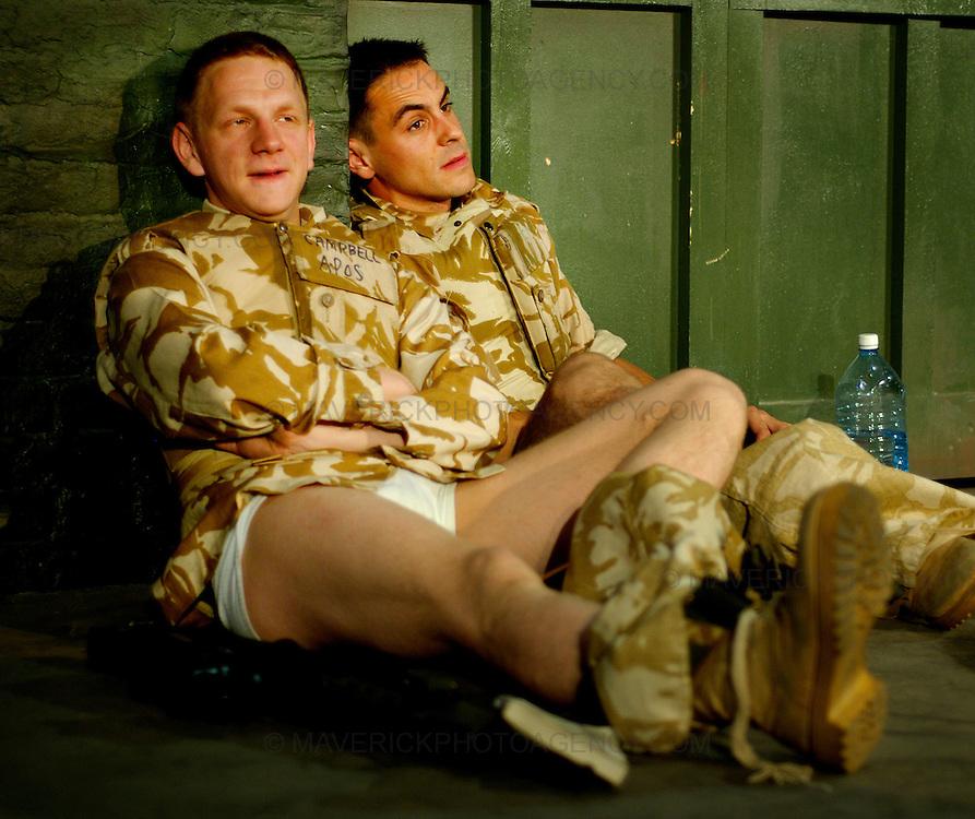 "National Theatre of Scotland play "" Blackwatch "" at the Edinburgh University Drill Hall.  The play is part of this years Edinburgh Festival Fringe.  Pictured  Brian Ferguson (Blonde Hair) as Cammy and top Emun Elliott (Dark hair) as Fraz."