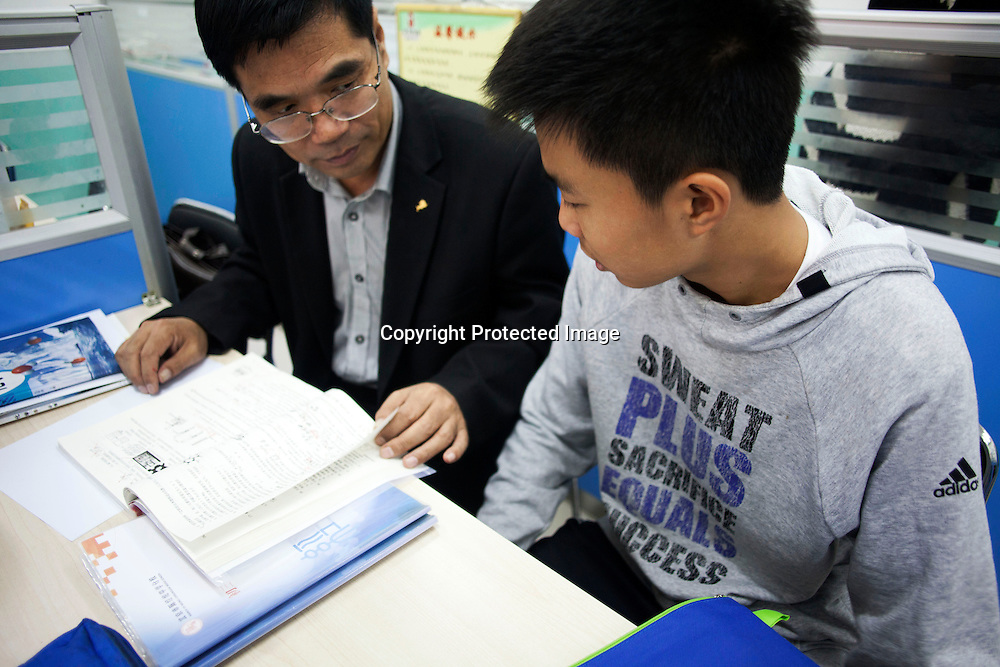 BEIJING, OCT.18, 2014 : Song Yonglin, 14, listens to his chemistry teacher . He spends every weekend taking extra school lessons in order to improve his scores which cost his parents about 4-5000 Yuan/month. He would like to switch to the International school in Beijing  and study economics later on in the US.