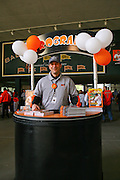 A member of the Baltimore Orioles staff sells programs before the start of opening day at Oriole Park at Camden Yards on Friday, April 9, 2010.