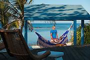 romantic dusk image of couple in hammock, Little Cayman