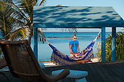 romantic dusk image of couple in hammock, Little Cayman