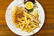 Fish and chips: Close up of pub lunch plate at the White Horse Inn at Hascomb, UK. Lunch with Richard and Fenella Hodson, Godalming, UK. (Material World Family from Great Britain UK) and photographer David Reed.