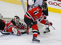 February 20, 2008; Newark, NJ, USA;  New Jersey Devils goalie Martin Brodeur (30) makes a save on a shot by San Jose Sharks right wing Jonathan Cheechoo (14) during the third period at the Prudential Center in Newark, NJ.  The Devils beat the Sharks 3-2.