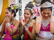 19 APRIl 2014 - BANGKOK, THAILAND: Performers shriek their appreciation as their friends perform music from the Isaan region of Thailand at the Rattanakosin Festival in Bangkok. Rattanakosin is the name of the man made island that is the heart of the old city. Bangkok was formally founded as the capital of Siam (now Thailand) on 21 April 1782 by King Rama I, founder of the Chakri Dynasty. Bhumibol Adulyadej, the current King of Thailand, is Rama IX, the ninth King of the Chakri Dynasty. The Thai Ministry of Culture organized the Rattanakosin Festival on Sanam Luang, the royal parade ground in the heart of the old part of Bangkok, to celebrate the city's 232nd anniversary.    PHOTO BY JACK KURTZ