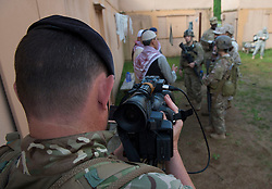 Image shows Coprporal Sean Hayes, Media Operations Group filming as troops from 77 Brigade exercise with the United States Marine Corps and Army at Quantico Marine Corps Base, Quantico Virginia. <br /> <br /> 19/05/2015<br /> <br /> Elements of 77X are working with American troops on Combined Unit Exercise (CUX) 15.2 - a 3 week exercise meant to test Marine Corps Information Operations Centre (MCIOC) personnel in a variety of Information<br /> Operation techniques. <br /> <br /> <br /> Credit should read: Cpl Mark Larner RY