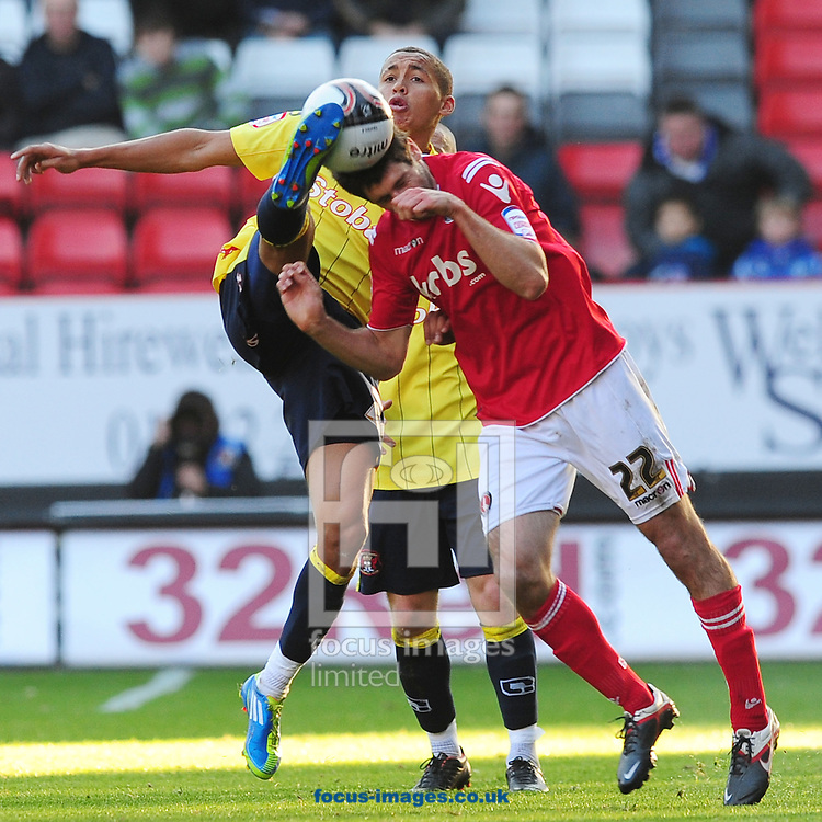 Picture by Alex Broadway/Focus Images Ltd.  07905 628187.22/10/11.Danny Hollands of Charlton and James Tavernier of Carlisle during the Npower League One match at The Valley stadium, London.