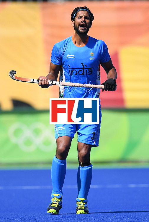 India's Rupinder Pal Singh shouts during the men's field hockey Netherland's vs India match of the Rio 2016 Olympics Games at the Olympic Hockey Centre in Rio de Janeiro on August, 11 2016. / AFP / MANAN VATSYAYANA        (Photo credit should read MANAN VATSYAYANA/AFP/Getty Images)