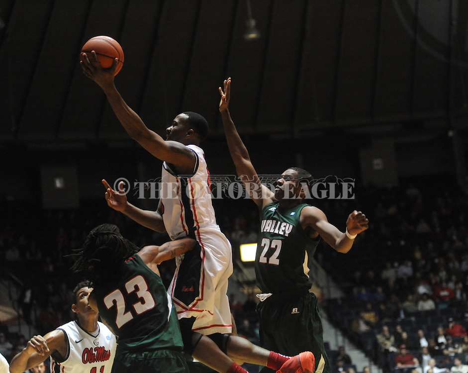 Ole Miss' Ladarius White (10) vs. Mississippi Valley State's Blake Ralling (22) at the C.M. Tad Smith Coliseum in Oxford, Miss. on Friday, November 22, 2013. (AP Photo/Oxford Eagle, Bruce Newman)