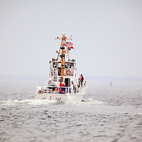 "The United States Coast Guard Auxiliary boat Lady M leaving the Coast Guard Station Sandy Hook.  The Coast Guard Auxilary was established on June 23, 1939 by an act of Congress as the United States Coast Guard Reserve and re-designated as the Auxiliary on February 19, 1941. The Auxiliary is an incorporated, civilian volunteer component of the United States Coast Guard (""USCG"")."