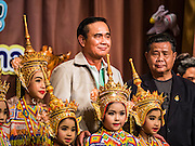 09 JANUARY 2016 - BANGKOK, THAILAND:      PRAYUTH CHAN-O-CHA, the Prime Minister of Thailand, with school children dressed as traditional Thai dancers during Children's Day festivities at Government House. National Children's Day falls on the second Saturday of the year. Thai government agencies sponsor child friendly events and the military usually opens army bases to children, who come to play on tanks and artillery pieces. This year Thai Prime Minister General Prayuth Chan-ocha, hosted several events at Government House, the Prime Minister's office.      PHOTO BY JACK KURTZ