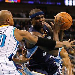 January 19, 2011; New Orleans, LA, USA; Memphis Grizzlies power forward Zach Randolph (50) drives past New Orleans Hornets power forward David West (30) during the second quarter at the New Orleans Arena.   Mandatory Credit: Derick E. Hingle