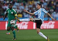 Argentina's forward Angel Di Maria (R) kicks the ball past Nigeria's defender Joseph Yobo during the World Cup South Africa 2010 soccer match, at Soccer City stadium, in Johannesburgo, South Africa, on June 12, 2010.  (Alejandro Pagni/PHOTOXPHOTO)