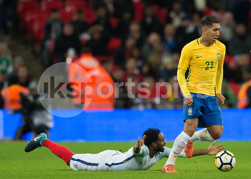 Roberto Firmino of Brazil and Danny Rose of England during the International Friendly match between England and Brazil at Wembley Stadium, London, England on 14 November 2017. Photo by Vince Mignott.