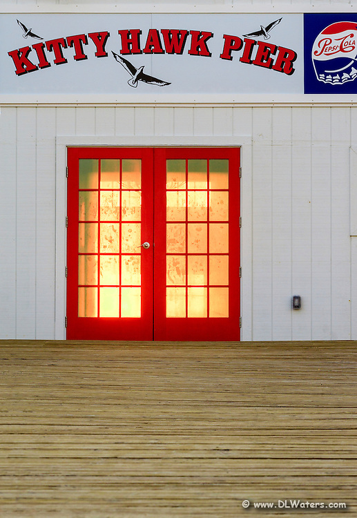 Morning sun shining through the red doors at Kitty Hawk pier.