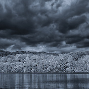 """""""Every Cloud Has a Silver Lining"""" monochrome<br /> <br /> Dramatic skies over water on a stormy fall day! A beautiful black and white landscape!"""