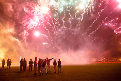 © Licensed to London News Pictures. 05/11/2015. Lewes, UK. People watching a fireworks display in Lewes, Sussex during the traditional Bonfire Night celebrations on Thursday, 5 November, 2015. Thousands of people attend the parade through the narrow streets of Lewes and burn effigies to celebrate Guy Fawkes night. Photo credit: Tolga Akmen/LNP