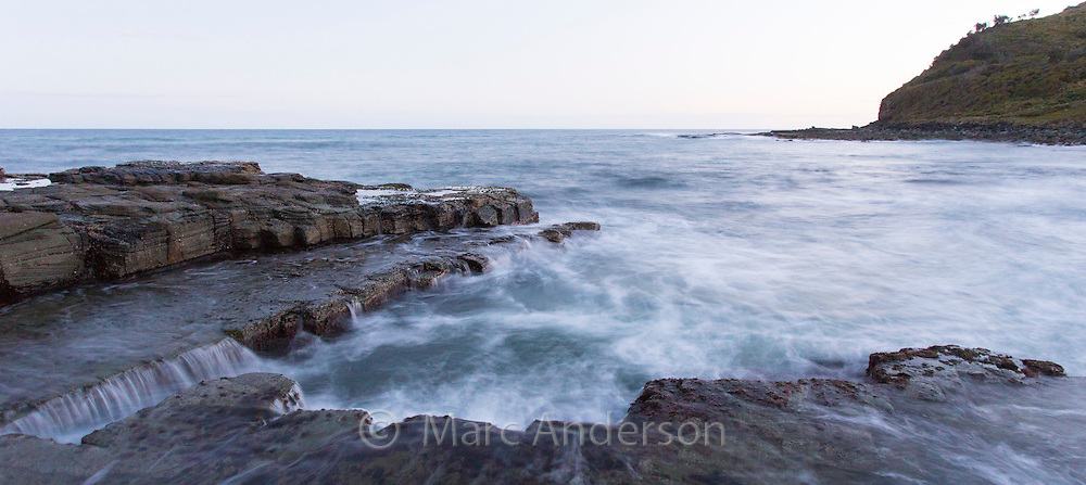 Waves on a rocky shore on a coastline in the Royal National Park, NSW, Australia