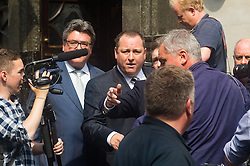 Portcullis House, Westminster, London. Sports Direct and Newcastle United owner Mike Ashley, centre, leaves Westminster's Red Lion pub next door to Portcullis House before appearing in front of the Business, Innovation and Skills select committee, where he is to be questioned about working practices at his firm's distribution centre in Derbyshire.
