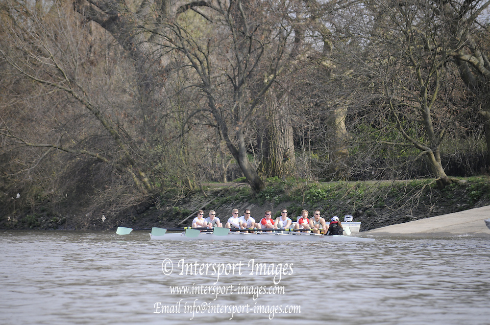 Putney. London. Tideway Week build up to the   2011 University Boat Race over parts of the Championship Course - Putney to Mortlake. Cambridge, CUBC [Blue Boat], paddle back to Putney, from the afternoon training session. Tuesday 22/03/2011  [Mandatory Credit; Karon Phillips/Intersport-images]..Crews:.CUBC. Bow Mike THORP, 2 Joel JENNINGS, 3 Dan- RIX STANDING, 4 Hardy CUBASCH, 5 George NASH, 6 Geoff ROTH, 7 Derek RASMUSSEN, Stroke David NELSON and Cox Liz BOX. ... 2011 Tideway Week