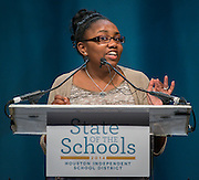 Kaleigh Davis of the Energy Institute High School greets guests during the Houston ISD State of the Schools luncheon at the Hilton of the Americas, February 26, 2014.