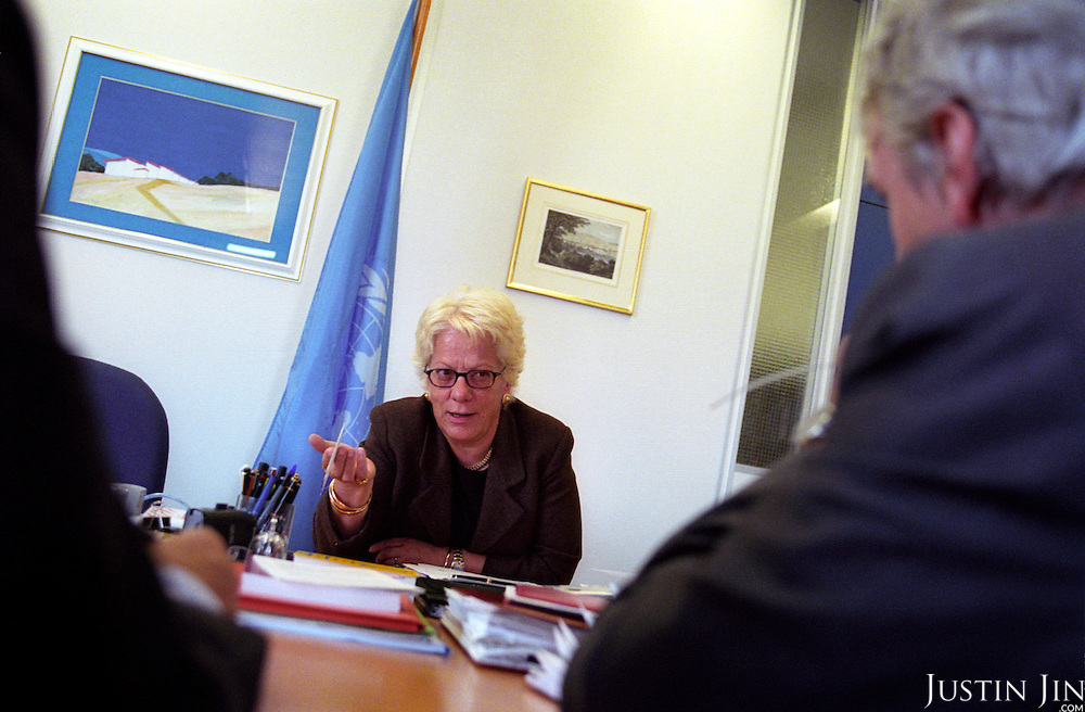 Portrait of Carla del Ponte talking with reporters at her office at the ICTY in the Hague.