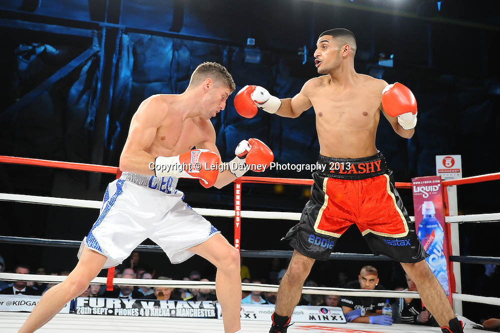 Muheeb Fazeldin (red/black shorts) defeats Leo D'Erlanger in a boxing contest on Saturday 14th September 2013 at the Magna Centre, Rotherham. Hennessy Sports. Self billing applies. © Credit: Leigh Dawney Photography.