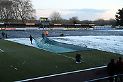 Clearing the pitch covered in snow during the EFL Sky Bet League 1 match between AFC Wimbledon and Blackburn Rovers at the Cherry Red Records Stadium, Kingston, England on 27 February 2018. Picture by Matthew Redman.