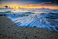 Morning sunrise with streaming wave on sandy beach at Waipouli, Kauai Hawaii