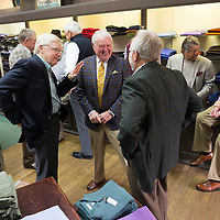 Jimmy Long, center, laughs as he talks to Reed Hillen, left, and Rick Maynard during Long's retirement reception at MLM Clothiers in downtown Tupelo.
