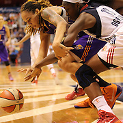 Brittney Griner, (left), Phoenix Mercury, and Chiney Ogwumike, Connecticut Sun, contest for a stripped ball during the Connecticut Sun Vs Phoenix Mercury WNBA regular season game at Mohegan Sun Arena, Uncasville, Connecticut, USA. 12th June 2014. Photo Tim Clayton