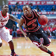 MOBILE, AL - DECEMBER 29:  Cameron Golden #0 of the Arkansas State Red Wolves maneuvers around Barrington Stevens III #4 of the South Alabama Jaguars at USA Mitchell Center on December 29, 2012 in Mobile, Alabama. At halftime Arkansas State leads South Alabama 28-23. (Photo by Michael Chang/Getty Images) *** Local Caption *** Cameron Golden;Barrington Stevens III
