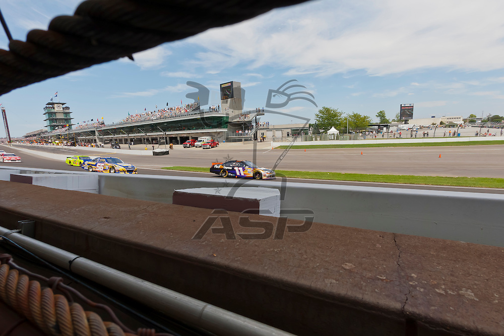 INDIANPOLIS, IN - JUL 29, 2012:  Denny Hamlin (11) brings his car through the turns during the Curtiss Shaver 400 presented by Crown Royal Sprint Cup Series race at the Indianapolis Motor Speedway in Indianapolis, IN.