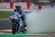 #42 Alex Rins, Spanish: Team Suzuki Ecstar smokes the rear tyre and shows his appreciation of the Suzuki by patting his fairing during the Gran Premio Motul de la Comunitat Valenciana at Circuito Ricardo Tormo Cheste, Valencia, Spain on 17 November 2019.
