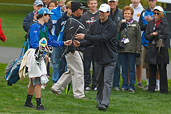 Feb 11, 2012; Pebble Beach CA, USA; Green Bay Packers quarterback Aaron Rodgers grabs his putter during the third round of the AT&T Pebble Beach Pro-Am at Pebble Beach Golf Links. Mandatory Credit: Jason O. Watson-US PRESSWIRE