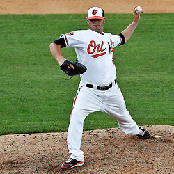 March 20, 2012; Sarasota, FL, USA; Baltimore Orioles relief pitcher Zach Phillips (58) throws during the top of the ninth inning of a spring training game against the Philadelphia Phillies at Ed Smith Stadium.  Mandatory Credit: Derick E. Hingle-US PRESSWIRE