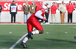 04 October 2014: Josh Burch scoops up a kick off and starts his return during an NCAA FCS Missouri Valley Football Conference game between the South Dakota State Jackrabbits and the Illinois State University Redbirds at Hancock Stadium in Normal Illinois