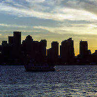 Boston panoramic skyline sunset with Boston Harbor. Boston Massachusetts is a major city along the Atlantic Ocean on the East coast of the United States.