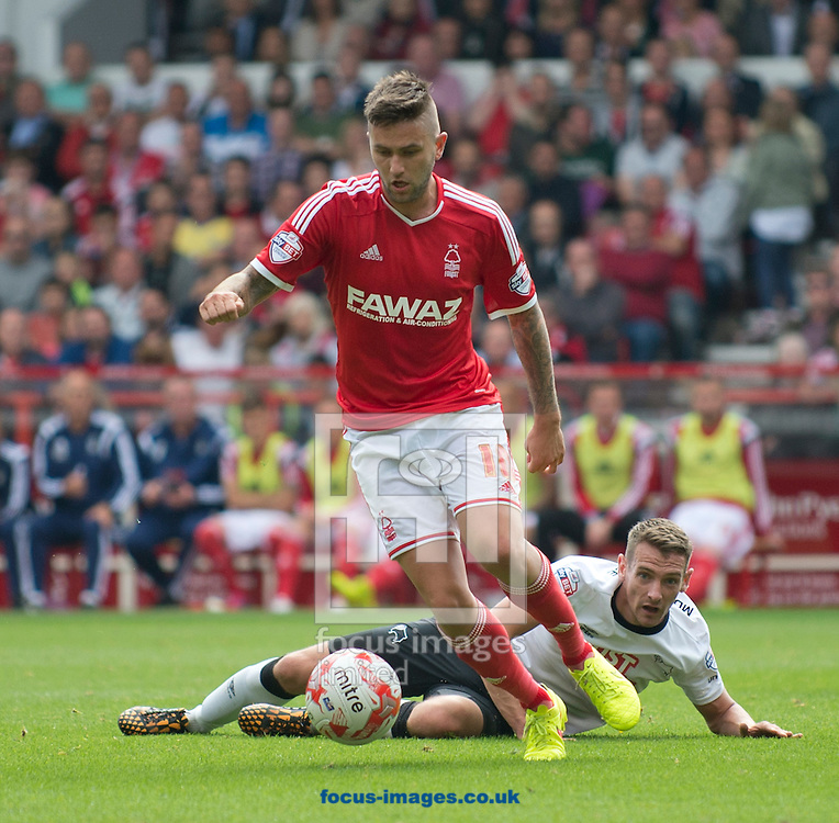 Henri Lansbury of Nottingham Forest in possession during the Sky Bet Championship match at the City Ground, Nottingham<br /> Picture by Russell Hart/Focus Images Ltd 07791 688 420<br /> 14/09/2014